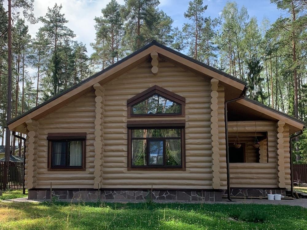 Сруб деревянного дома из круглого бревна